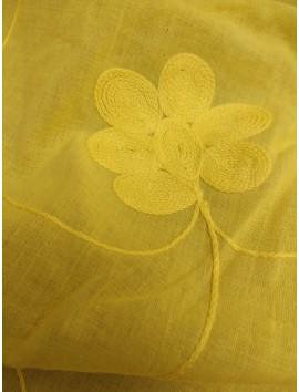 Batista amarilla de algodón con flores color