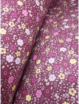 Tela sábana estampado floral fondo morado