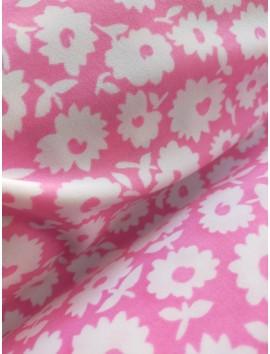 Tela de Punto de lycra rosa flores blancas