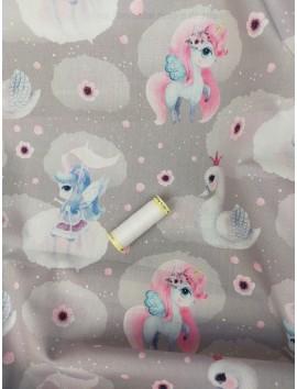 Tela de algodón unicornios rosas y azules fondo gris