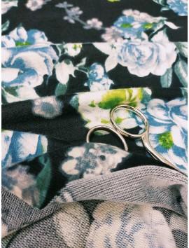 Tela de Punto jersey flores azules